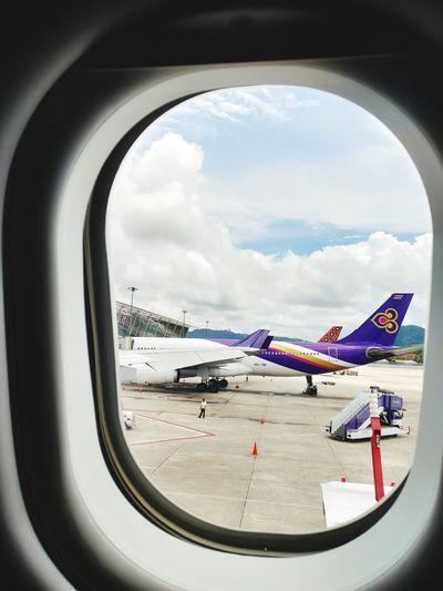 Airplane flying over sea seen through window