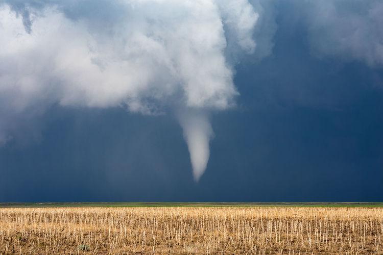 Scenic view of tornado over field