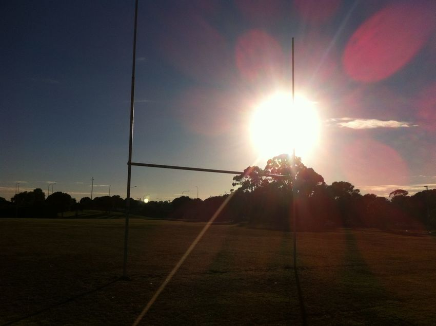 Beauty In Nature Bright Clear Sky Countryside Day Football Field Glowing Landscape Lens Flare Nature New Zealand Sports No People Non-urban Scene Outdoors Outline Remote Rugby Field Rugby Pitch Scenics Setting Sun Solitude Sun Sunbeam Sunlight Tranquil Scene