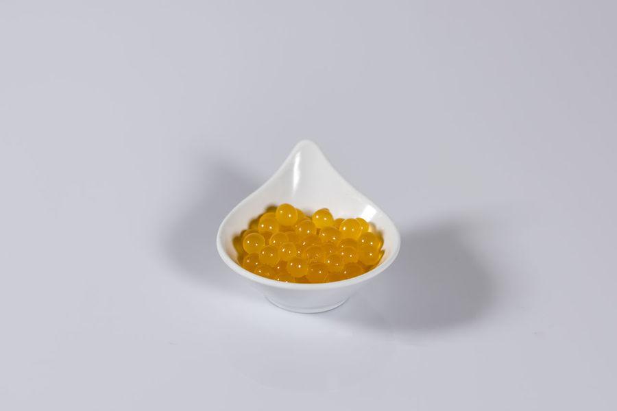 orange juice balloons in bowl Balloons Drink Food Food And Drink Fruit Healthy Healthy Eating Juice Orange Product Studio White Bowl