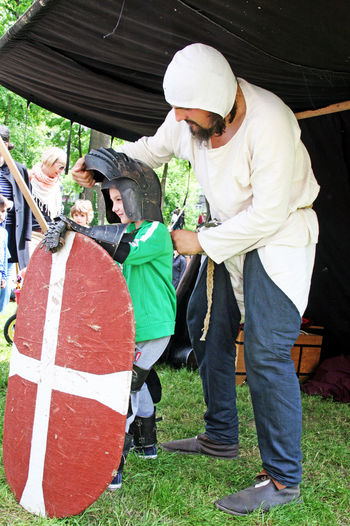 St.George's Day,fair,32,dressing the child knight,Zagreb,Croatia,EU, 2016. Armour Armouring Child Day Dressing Up Eu Fair Fun Knights Leisure Activity St.George's Day Teacher Weapons Zagreb, Croatia