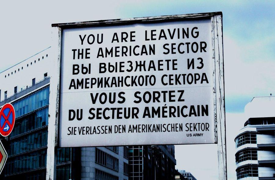 RePicture Travel Check Point Charlie Berlin Streetsign Languages Historical Landmark Worldwar2 Border Crossing Americanborderline U.s. Army Seeing The Sights