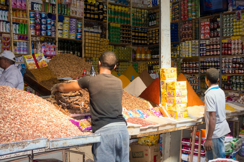 Shop Assistants Filling up Stock at Rissani Market Market Morocco Rissani Travel Business Food Food And Drink Men People Real People Retail  Shop Shop Assistant
