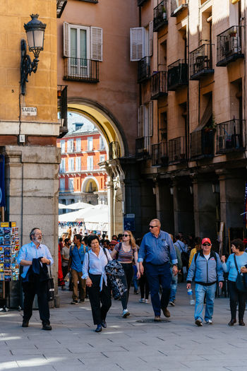 Plaza Mayor in historic center of Madrid Architecture Group Of People Built Structure Real People Men Building Exterior Crowd Day City Lifestyles Building Outdoors City Cityscape Madrid Travel Destinations Europe European  Sighseeing Tourism Plaza Mayor Square Arcade Street