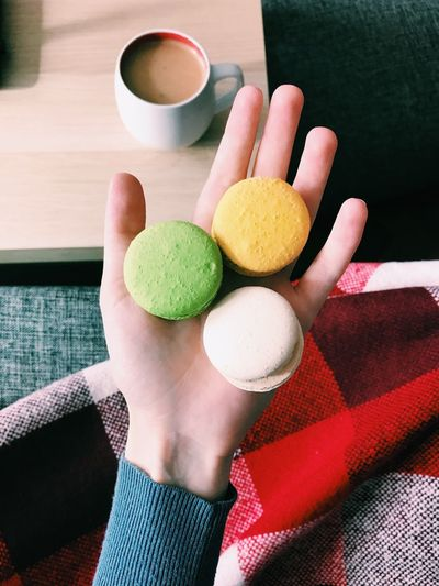 Food And Drink Human Hand One Person Holding Real People Human Body Part Food Indoors  Coffee Cup Freshness Human Finger Drink Lifestyles Sweet Food Temptation Women Healthy Eating Ready-to-eat Close-up Day Macarons Macaroons Macaron Macaroon Breakfast