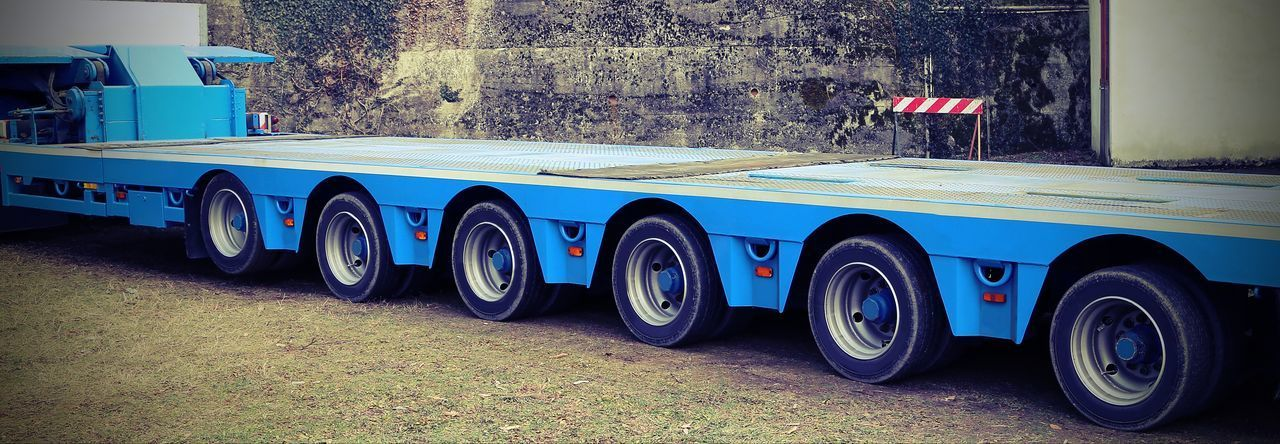very long blue truck with six axles of wheels for exceptional transport with vintage effect Convoy  Delivery Industry Road Transport Transportation Transporter Effect Huge Long Vehicle Many Monster Truck Multiwheel Muti Shipping  Transportation Vehicle Truck Trucks Trucks And Wheels Vintage