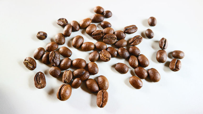 The Coffee Bean Brown Close-up Coffee - Drink Coffee Bean Coffee Cup Food Food And Drink Freshness Group Of Objects High Angle View Indoors  Mocha No People Raw Coffee Bean Roasted Roasted Coffee Bean Scented Still Life Studio Shot White Background