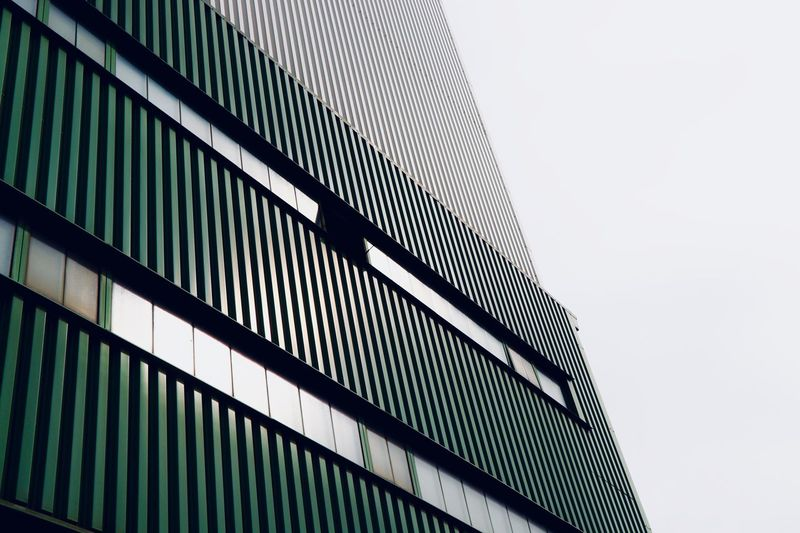one open window Factory Building Low Angle View Architecture Built Structure Building Exterior Sky Building No People Clear Sky Modern Pattern Office Building Exterior Office Tall - High Repetition City The Architect - 2018 EyeEm Awards