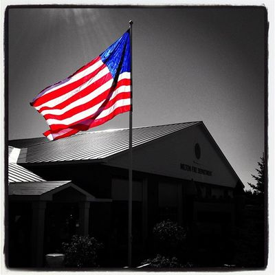Sun Shines on The Stars & Stripes. #miltonvt #vt USA Instagood Blackwhite Webstagram Bw Firehouse Iphoneonly Vt Photooftheday Insta_america Picoftheday 802 Glory Miltonvt Vermont Igharjit Vermontbyvermonters Patriotic Vt_scene Vermont_scene All_shots Igvermont Instamood Igvt Bestoftheday Firestation Selective_coloring Flag Redwhiteblue