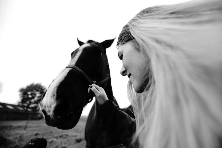 This shot was taken during a weekend with my colleagues. A small walk through the farmlands was a great break from working! Girl Perspective Hair OpenEdit Horses Farm Black And White Blackandwhite Mammal Real People Livestock Day Pets Side View Outdoors Young Women Young Adult Blond Hair Sky