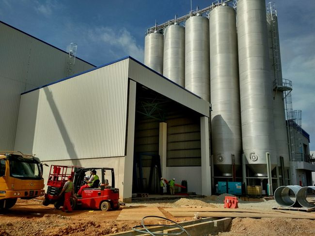 Silo. Contruction work. Factory Industry Built Structure Outdoors Day Contruction Zone Contruction Agriculture Industry Manufacturing Equipment Engineering