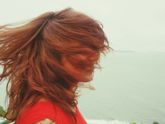 Wind in the hair... Brown Hair Beach Freedom Sky Water One Woman Only Young Women Sea Windy Hair
