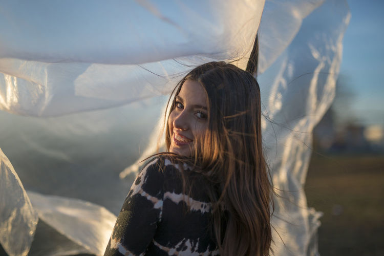 One Person Hair Portrait Long Hair Headshot Hairstyle Young Adult Women Brown Hair Young Women Day Leisure Activity Looking Real People Lifestyles Clothing Winter Nature Warm Clothing Outdoors Wind Beautiful Woman Contemplation Scarf Teenager