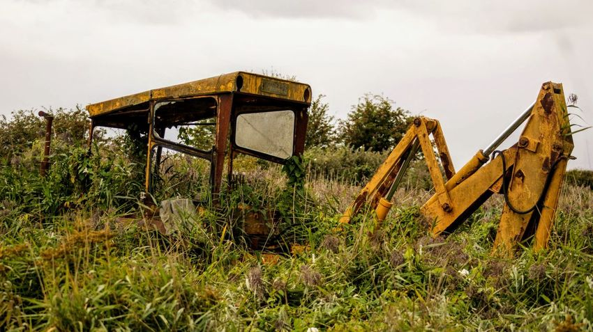 Weathered Wreck Wrecked Digger Yellow Overgrown Farmyard Machinery Oil Pump Rural Scene Rusty Sky Grass Deterioration Ruined Run-down Abandoned Damaged Bad Condition Obsolete Discarded Broken Old Ruin