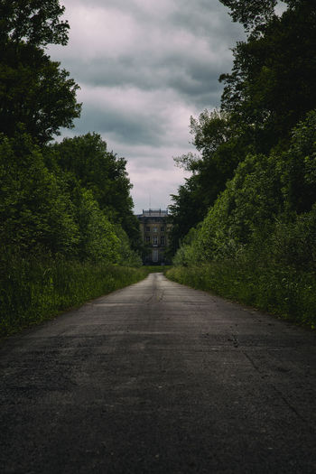 Chateau, big house castle in French isolated and surrounded by big green garden BIG Castle Château Cloudy Sky Entrance Europe France Garden Green House Invited Isolated Luxury Path Private Property Real Estate Renaissance Season  Sky Trees Visite Way Symmetry Negative Space