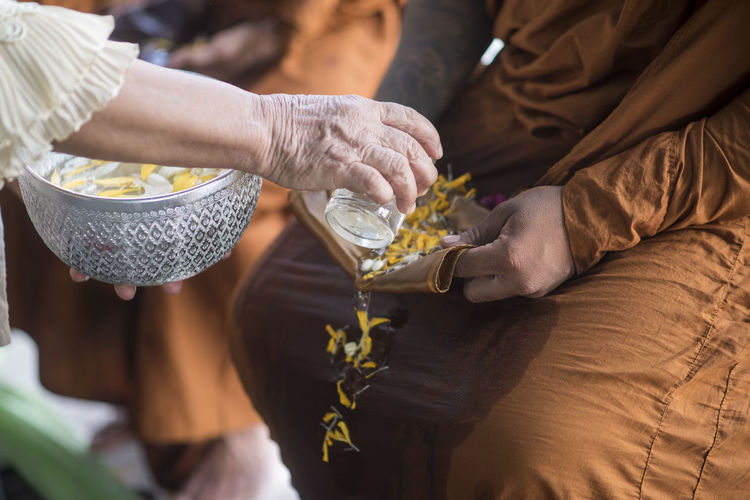 Close-up of hands performing ritual