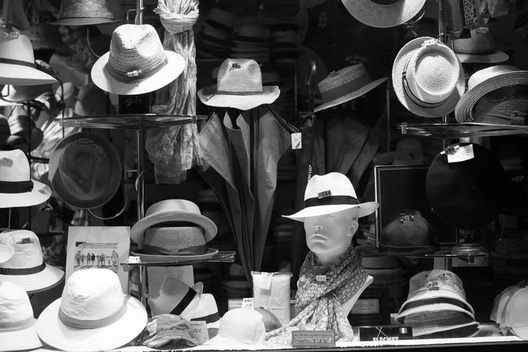 Various hats for sale at market
