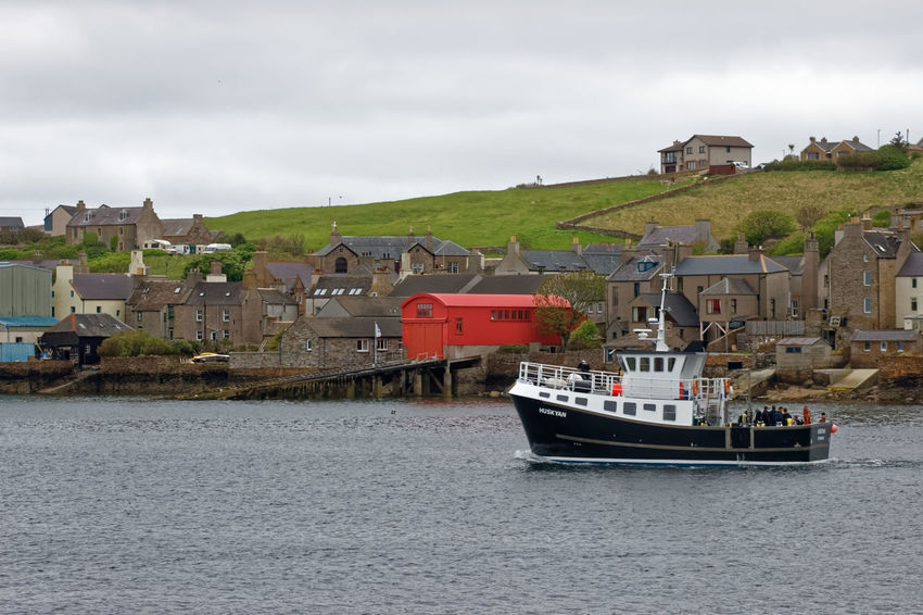 Stromness Harbour, Orkney Island, Scotland Bow Captain Cook Cruise Ship E.U. Fishing Harbor Harbour Hudson Bay Scotland United Kingdom Brexit Copland's Dock Cottage Cruise Fishing Industry Marine Renewables Plimsole Line Seawall Stone Material Tourism Tourist Destination Travel Destinations Trawler Well