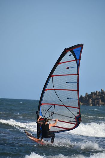 Windsurfing EyeEm Selects Summer Sports Water Sea Beach Sport Occupation Red Wave Windsurfing Water Sport Surfing Wetsuit Surfer Surf Surfboard