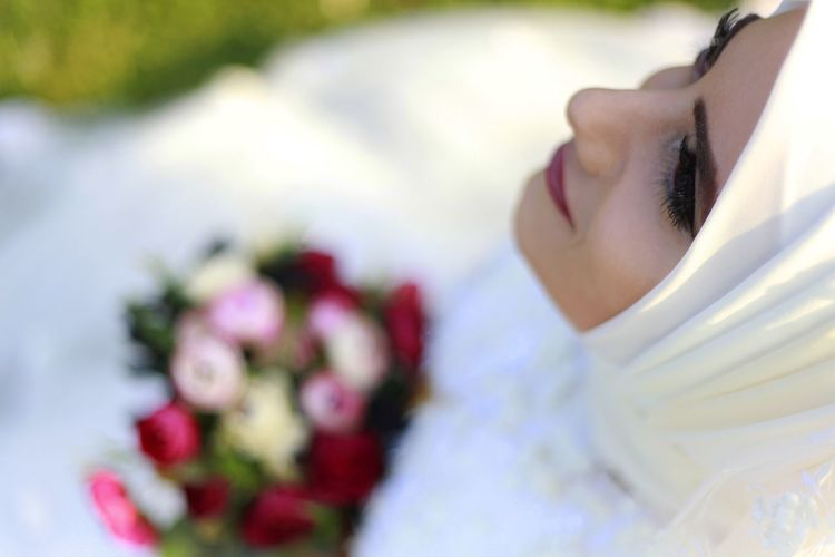 High Angle View Of Thoughtful Bride Wearing Hijab Outdoors