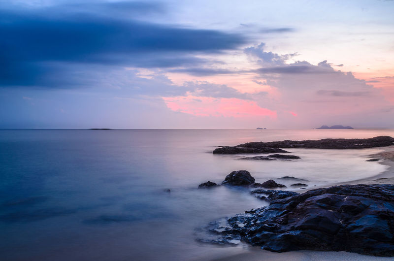 Water Sea Sky Horizon Over Water Beauty In Nature Horizon Scenics - Nature Cloud - Sky Tranquility Nature Rock Sunset Solid Rock - Object Tranquil Scene No People Land Beach Idyllic Outdoors