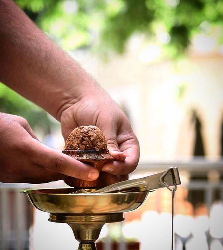 Cropped image of man preparing hookah