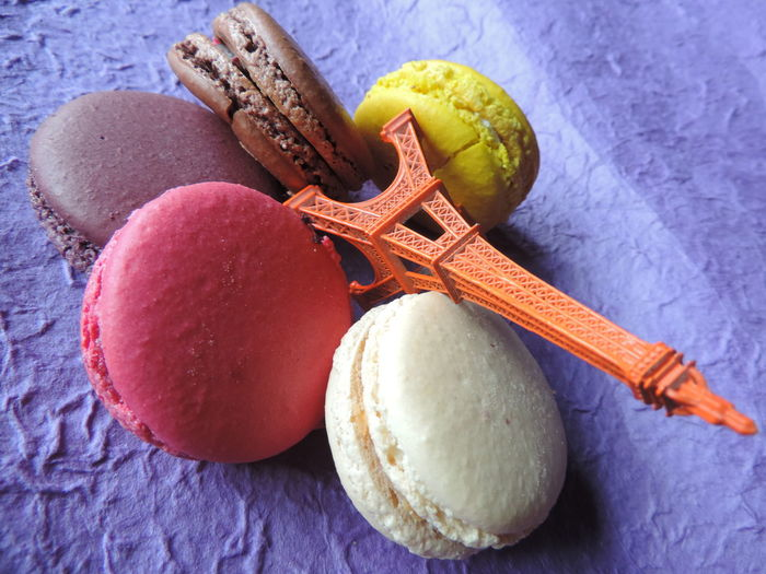 Close-up of colorful macaroons and replica eiffel tower