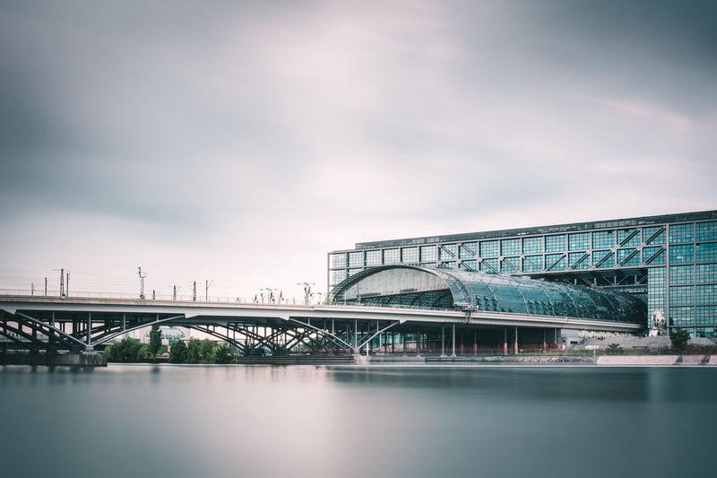 Berlin Hauptbahnhof Railway Station Over River Against Cloudy Sky