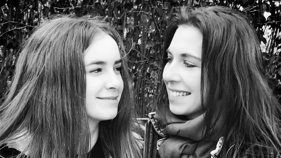 Mother & Daughter Long Hair Smiling Friendship Portrait Happiness Two People Young Women Young Adult Real People Headshot Togetherness Girls Beauty Love Motherlove Best Team Ever Face Profile Blackandwhite Black And White Photography Fearless And Faithful People EyeEmNewHere Resist My Love The Portraitist - 2017 EyeEm Awards Love Yourself This Is Family This Is Family Visual Creativity This Is My Skin A New Beginning Capture Tomorrow