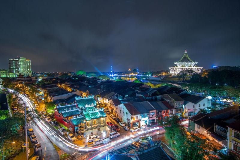 Light trail at kuching city at night raining day