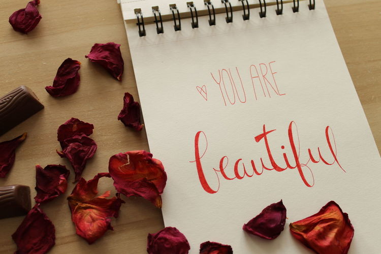 Text Indoors  Western Script Table Paper Red High Angle View Positive Emotion No People Freshness Still Life Communication Rose - Flower Love Emotion Flower Heart Shape Rosé Close-up Flowering Plant Message Valentine's Day - Holiday