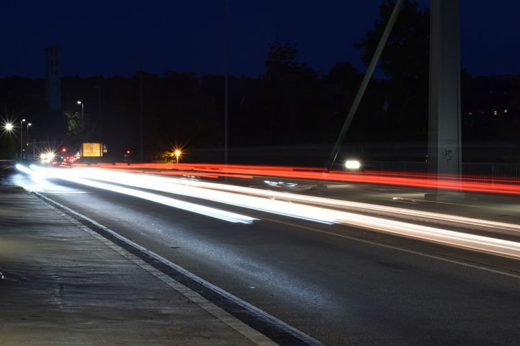 Architecture Blurred Motion Building Exterior Built Structure City Illuminated Light Trail Lighting Equipment Long Exposure Mode Of Transportation Motion Nature Night No People Outdoors Road Speed Street Street Light Transportation