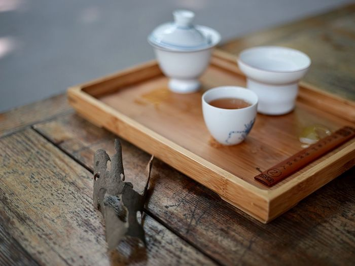 Close-up of tea in tray on wooden table