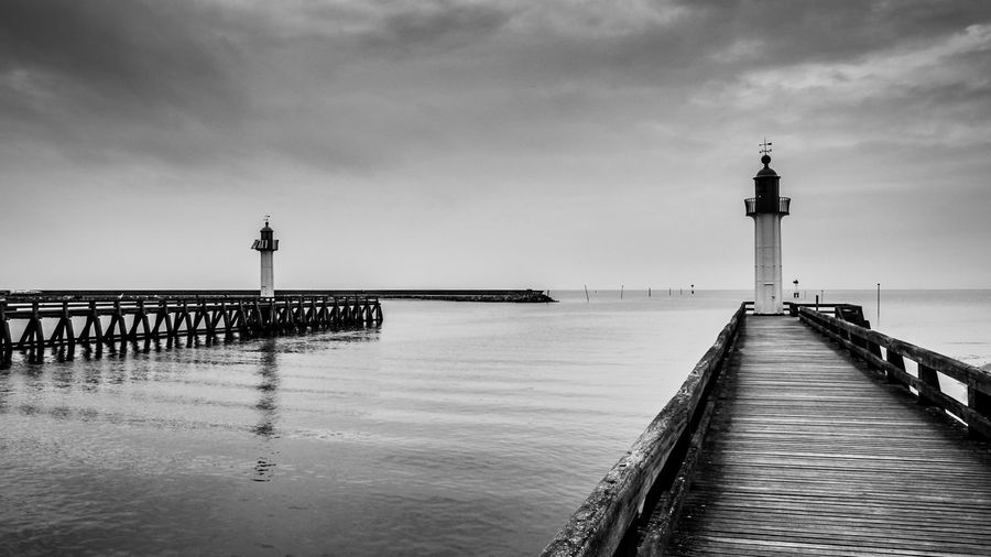 Ocean's door Sky Water Sea Built Structure Architecture Tower Direction Building Exterior Cloud - Sky Nature Pier Beach Incidental People The Way Forward Horizon Lighthouse Building Horizon Over Water Day Guidance