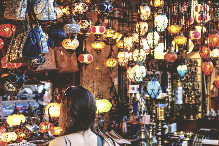 Rear view of woman in lantern shop at grand bazaar