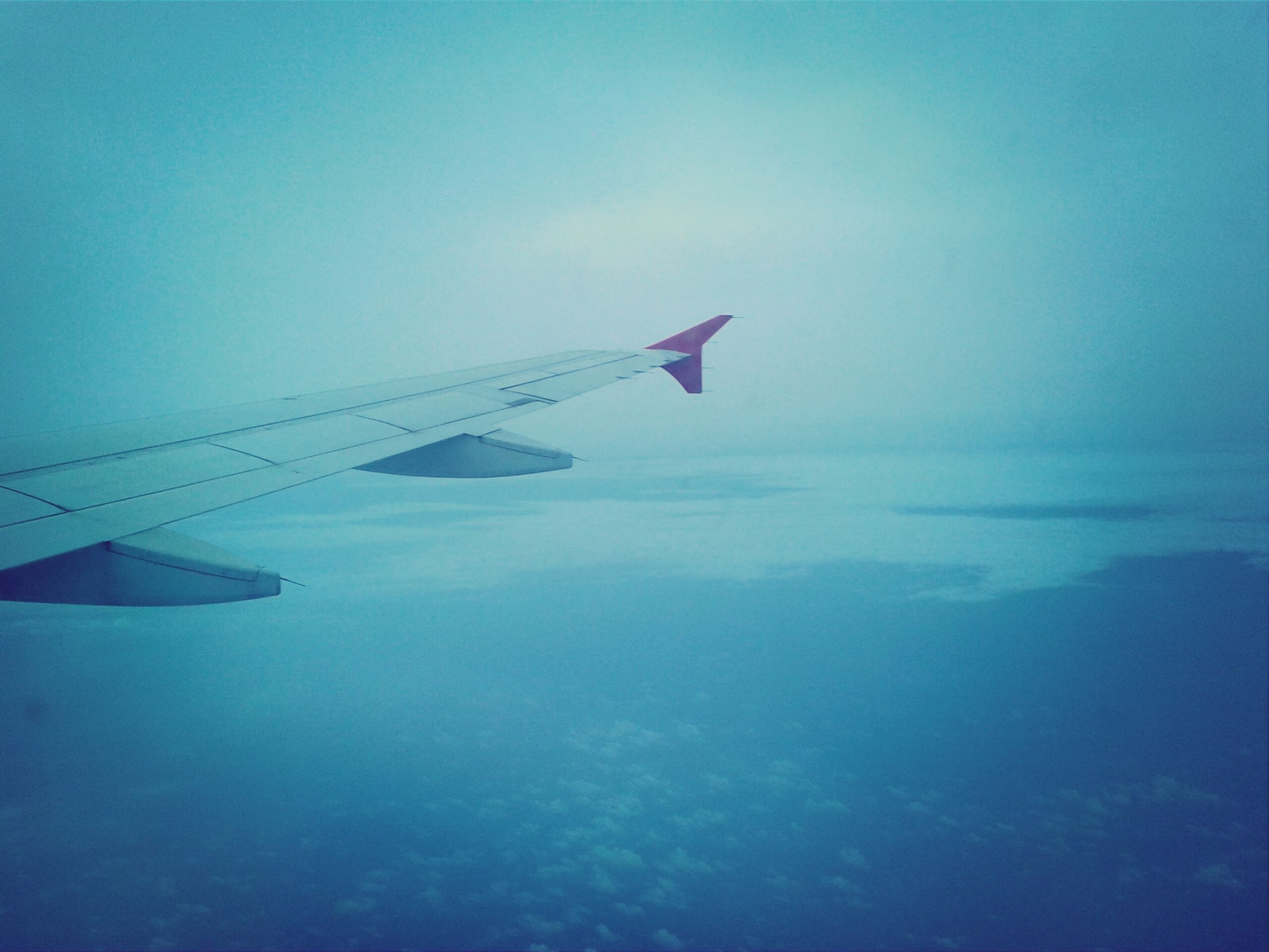 transportation, airplane, air vehicle, aircraft wing, mode of transport, flying, aerial view, part of, blue, travel, cropped, mid-air, journey, scenics, beauty in nature, on the move, nature, landscape, sky, airplane wing