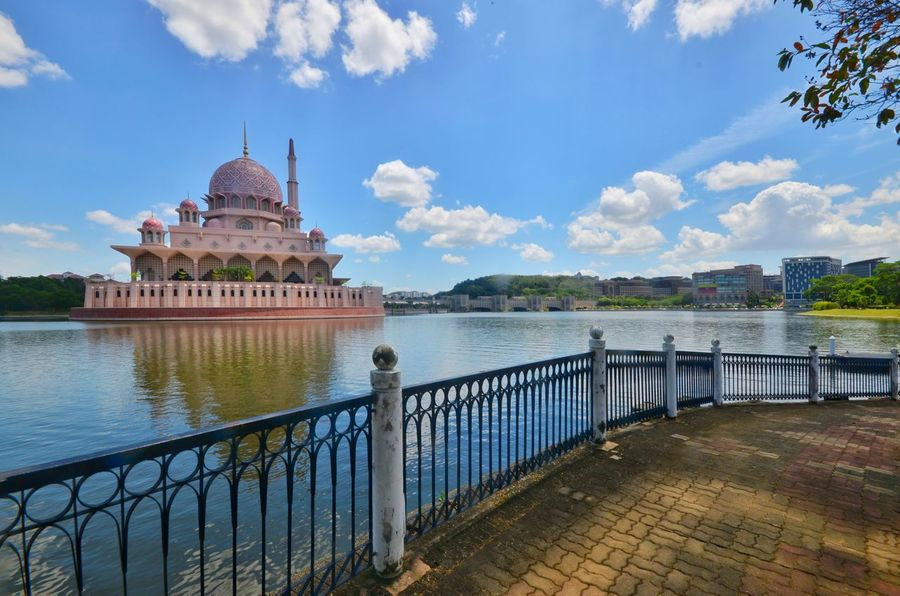 Masjid Putra - Putra Mosque in Malaysia Mosque Masjid Masjid Putra Masjid Putrajaya Lake Waterfront Lake Views Blue Sky Dome Minaret Ramadhan Eid Mubarak Muslim Nature Photography City Water Dome Lake Blue History Sunset Sky Architecture Building Exterior Castle Palace Pavilion Politics And Government Government