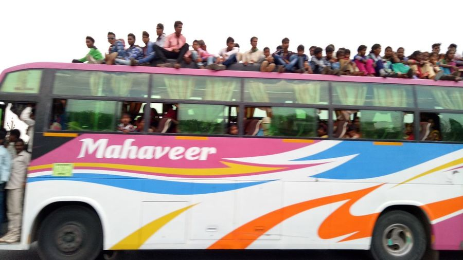 People Adult Outdoors Water Large Group Of People Day Adults Only Young Adult Many People Sitting On Bus Top Many People Motion