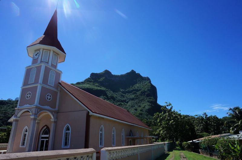 A church at Bora Bora Architecture Bell Tower Blue Bora Bora  Building Exterior Built Structure Church Clear Sky Day French Polynesia Mountain Nature No People Otemanu Mountain Outdoors Paradise Place Of Worship Religion Sky South Sea Spirituality Sunlight Traditional Tree Vaitape