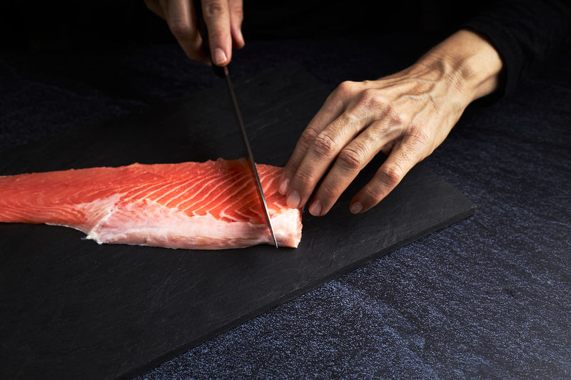 Midsection of person having fish