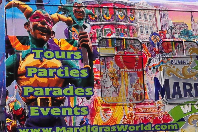 Side of a bus advertising the Mardi Gras Museum - New Orleans, USA New Orleans EyeEm Bus Advert Close-up Communication Day For Sale Freshness Mardi Gras Museum Men Multi Colored Outdoors People Real People Retail  Text Women