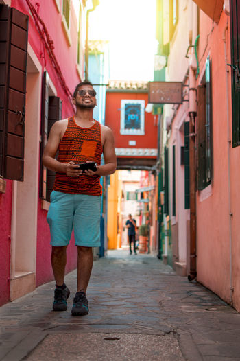 walking in the beautiful streets of burano Italian Italy Burano Town Colorful Europe Trip Travel Vacation Walking Indian Model Selfpotrait City Men Portrait Full Length Smiling Architecture Building Exterior Built Structure