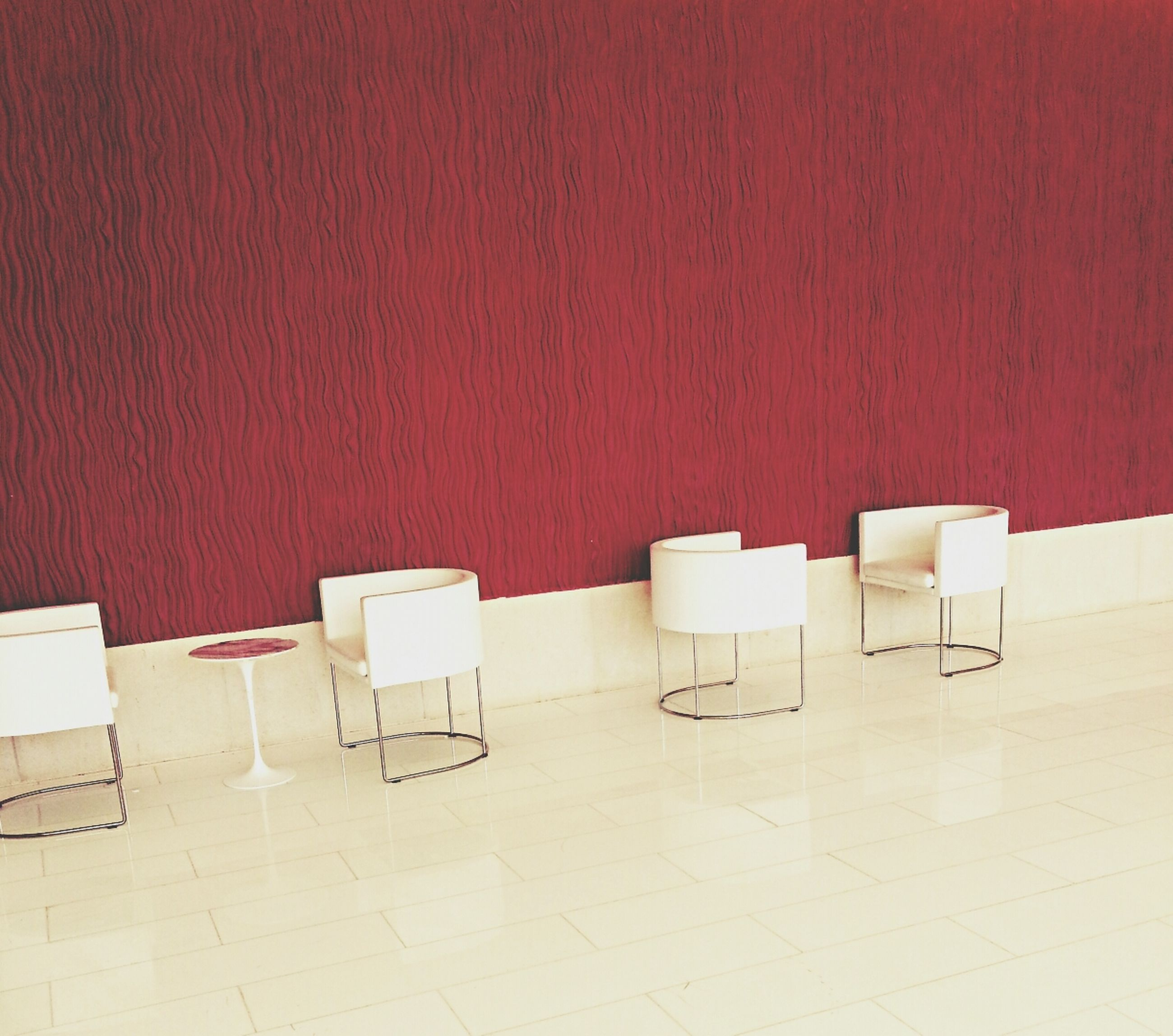 chair, empty, table, indoors, absence, wall - building feature, seat, wall, built structure, still life, architecture, red, tiled floor, furniture, no people, flooring, day, shadow, tile, side by side