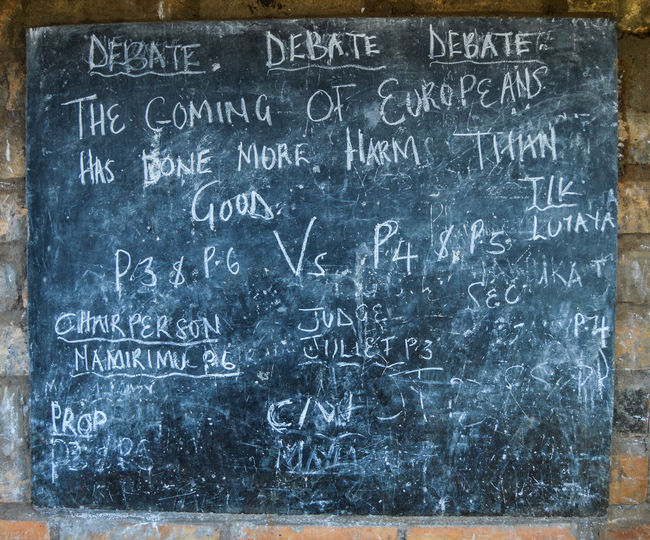 I managed to take a picture of the blackboard of one of the schools in ssesse islands which was in extremely poor shape. The topic of debate killed me though 😂 Debate Africa School Text Close-up Written Handwriting  Board Information