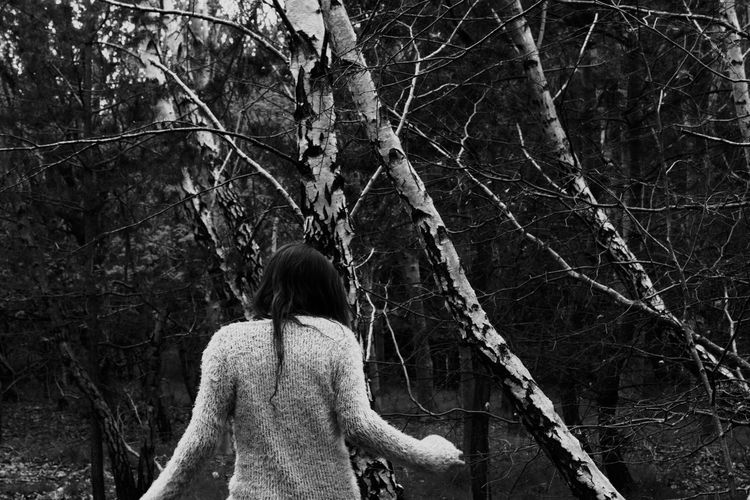 Bare Trees Black And White Branch Desaturated Forest Light And Shadow Nature One Person One Woman Only Outdoors Person In Nature Real People Rear View Standing Tree Woman In Forest