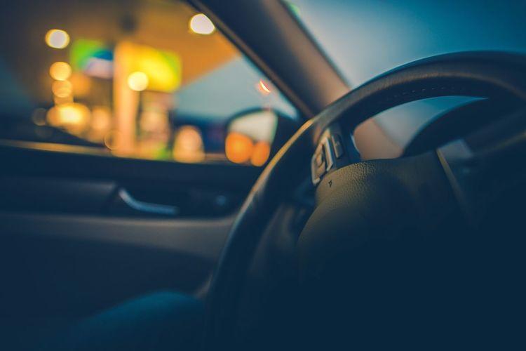 Close-up of car steering wheel at night