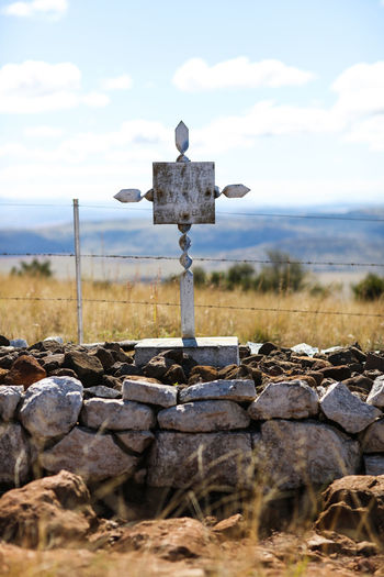 high resolution image available Anglo-Boer War Battlefield British Troops Bush Veld Cross Day Grave Stone Landscape Nature No People Non-urban Scene Outdoors Remote Scenics South Africa South African Anglo-boer War Spionkop Grave Stone Stone Stone - Object Stone Wall War Ground