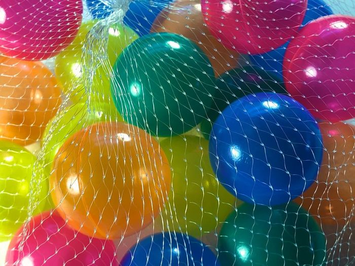 Party Time Surprise Selection Repetition Pick Any No People Net Multi Colored Group Day Colorful Color Choice Close-up Children Play Bunch Balls Balloons A Few Things Toys Shiny Reflection Ready To Play
