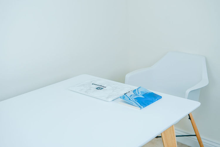 Theminimalist-2019eyeem Copy Space Indoors  Seat Table Chair No People White Color Still Life Wall - Building Feature Empty Blue Absence Paper Wood - Material High Angle View Close-up Office Relaxation Simplicity Blank