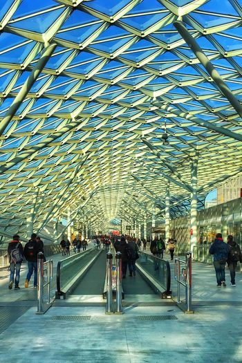 Architecture City Transportation City Life Built Structure Large Group Of People Modern Sky People Adults Only Real People Public Transportation Men Bridge - Man Made Structure Futuristic Outdoors Cultures Adult Day Milano Fieramilano